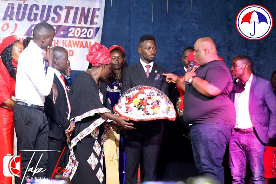 Inset Robert Kyagulanyi and Pastor Mondo Mugisha at Revival church Kawaala