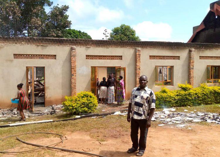 Bishop John Asaph Sserugga in-front of Bukomero Miracle Centre Church